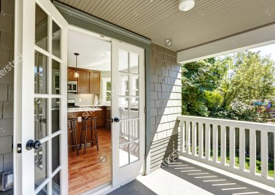 stock-photo-kitchen-room-with-exit-to-walkout-deck-with-railings-215658562
